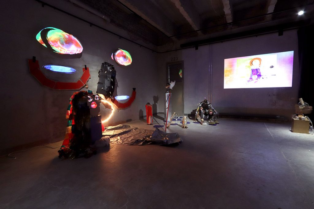 Art works made of recycled materials and a video projection